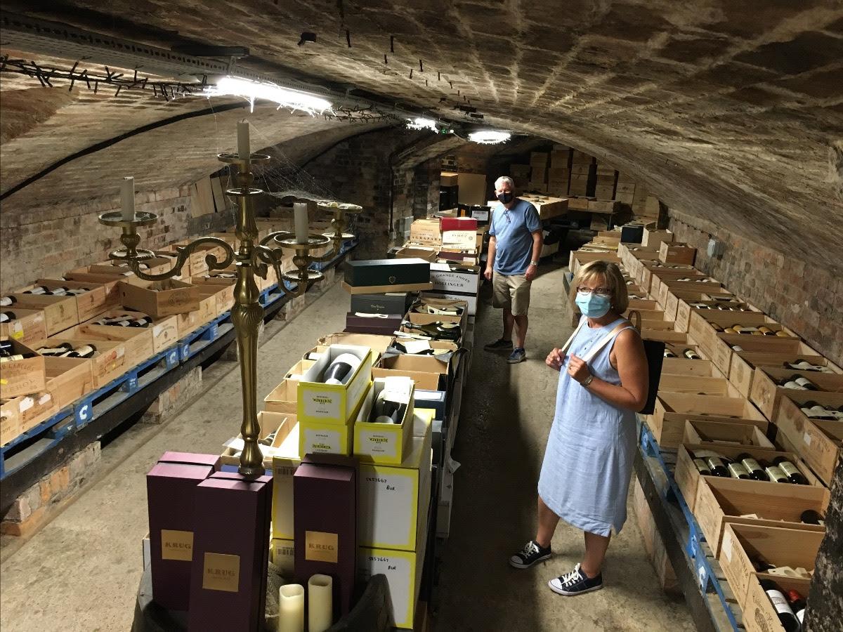 customers wearing covid masks in wine cellar